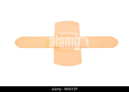 Stuck band-aid on a white background - Stock Photo