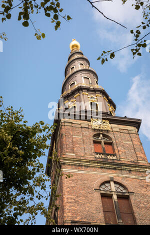 The spire on Vor Frelsers Kirke, or Church of Our Saviour, in Christianshavn, Copenhagen, with its external spiral staircase - Stock Photo