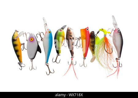 Close up image of different and colorful fishing lures against white background - Stock Photo