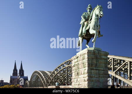 Equestrian Statue of Wilhelm I. with Cathedral and Hohenzollern Brigde, Cologne, Germany, Europe - Stock Photo