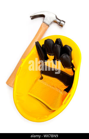 Two leather builder's gloves in a helmet with a claw hammer - Stock Photo