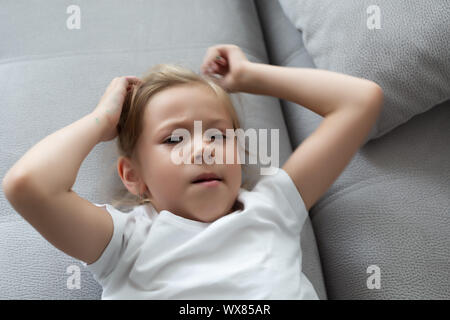 The girl scratches her head, severe itching, infection with lice - Stock Photo