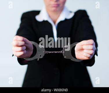 Business Woman tied up in handcuffs - Stock Photo