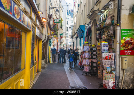 PARIS, FRANCE - 02 OCTOBER 2018: People walking on the narrow street in latin quarter in Paris. - Stock Photo