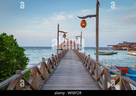 Wooden pier in tropical destination - Stock Photo