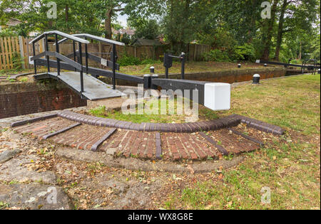 Typical pound lock on the Basingstoke Canal and towpath, Knaphill, Woking, Surrey, southeast England, UK - Stock Photo
