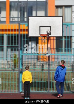 teenagers playing basketball - Stock Photo