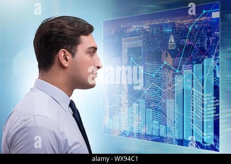 Businessman in futuristic stock trading concept - Stock Photo
