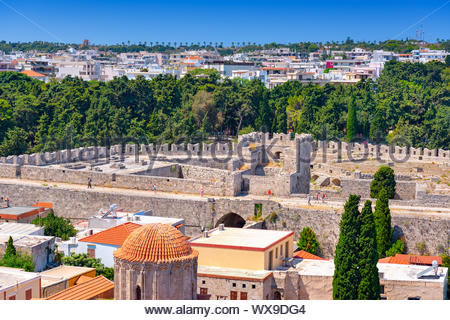Panoramic view of the Rhodes medieval stone defensive walls and the St Georges Bastion, with the new town and Acropolis in backg - Stock Photo