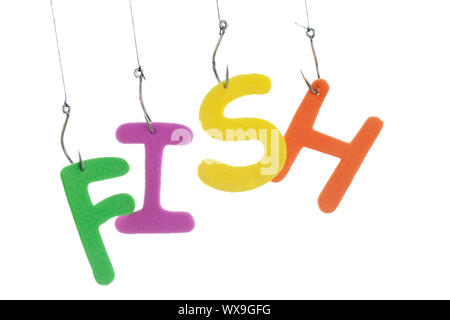 Close up image of fishing lures with alphabets trick in it against white background - Stock Photo