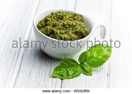 basil pesto in ceramic bowl - Stock Photo