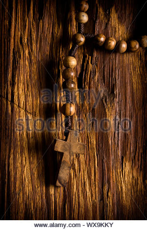 Wooden rosary beads hanging - Stock Photo