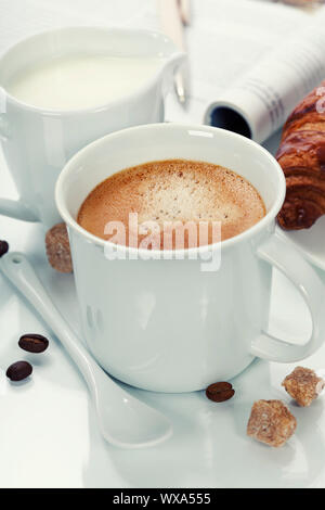breakfast with coffee, croissant and magazine - Stock Photo