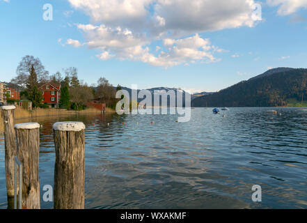 lake and boats in the mountains of Switzerland during evening and sunset - Stock Photo