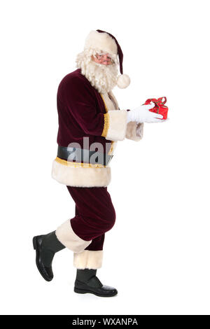 The real Santa Claus is walking by with luxury present - Stock Photo