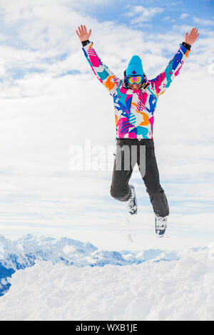 Young man a ski outfit jumping in snow at winter outdoor in the Zillertal Arena, Austria - Stock Photo