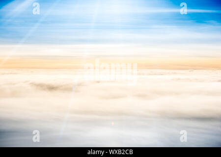 Beautiful airview with blue sky, white clouds and sunrays - Stock Photo
