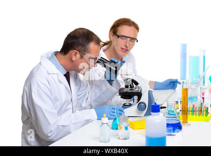 chemical laboratory with two scientist working with test tubes and microscope - Stock Photo