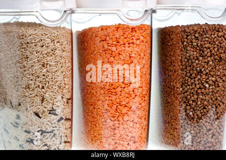 Rice red lentil and buckwheat in transparent plastic containers - Stock Photo