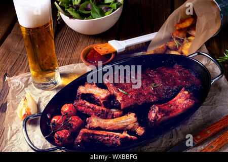 Grilled ribs in spicy marinade with salad and vegetables - Stock Photo