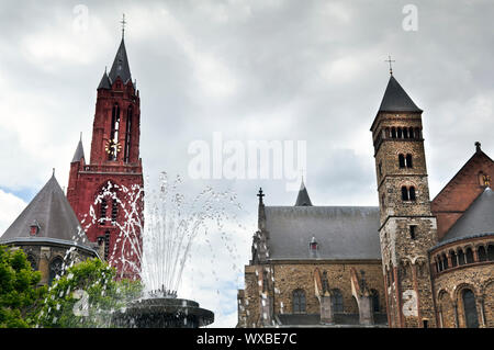 fountain on Vrijthof square and Saint Servatius Basilica in Maastricht, Netherlands - Stock Photo