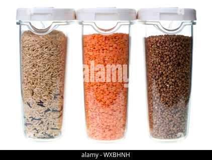 Rice red lentil and buckwheat in containers on white  background - Stock Photo