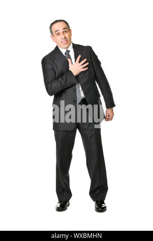 Businessman in a suit pretending to have a heart attack isolated on white background - Stock Photo