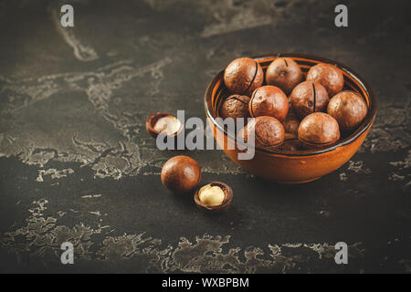 Macadamia nuts on wooden table