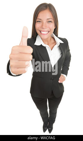 Woman giving thumbs up to the camera, that is above in high angle view. Wide angle, almost fish eye. Smiling mixed chinese asian / caucasian business - Stock Photo