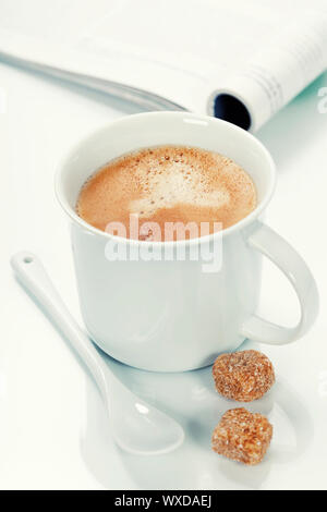 coffee and magazine on a table - Stock Photo