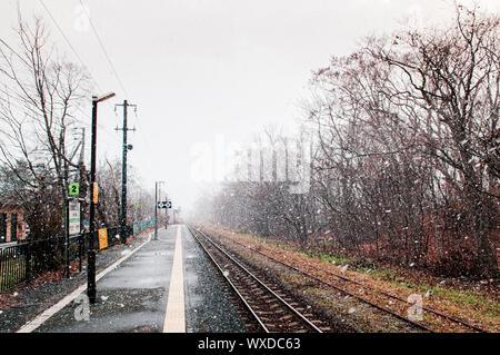 DEC 1, 2018 Hakodate, JAPAN - JR Onuma Koen station empty platform during snow fall in winter foggy atmosphere and beautiful nature scene - Stock Photo