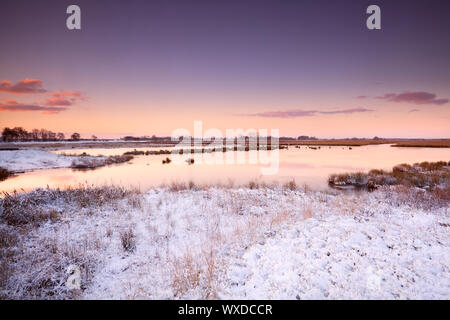dramatic sunrise over river in winter - Stock Photo