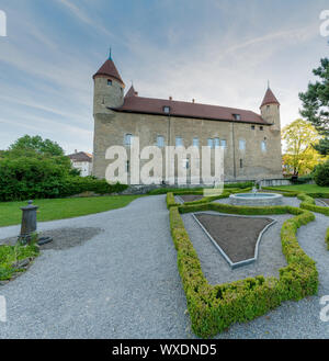 Bulle, FR / Switzerland - 1 June 2019: the gardens and the historic city hall administrative buildin - Stock Photo