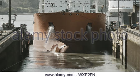 Cargo Ship Entering Miraflores Locks At Panama Canal, Panama - Stock Photo