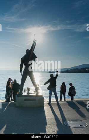 Montreux, VD / Switzerland - 31 May 2019: tourists visiting the Freddie Mercury Memorial Statue on t - Stock Photo