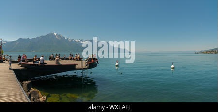 Montreux, VD / Switzerland - 31 May 2019: people enjoying the view and relaxing on the shores of Lak - Stock Photo