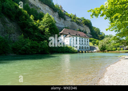 Fribourg, FR / Switzerland - 30 May 2019: historic hydroelectric power plant building on the river S - Stock Photo