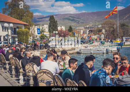 Crowded lakeside cafe in Ohrid - Stock Photo