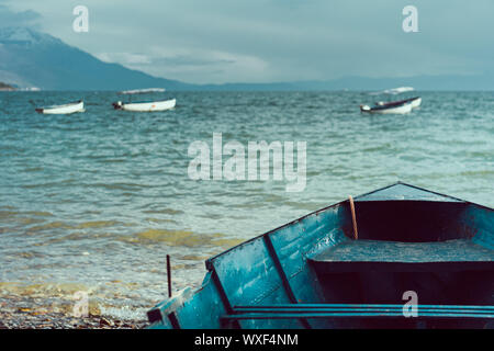Front of an old boat on the shore of Lake Ohrid - Stock Photo