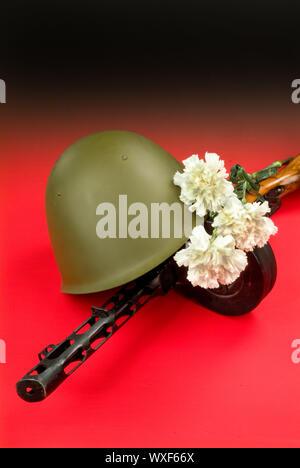 Machine Gun And Flowers - Stock Photo