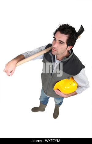 Workers with helmet in hand - Stock Photo