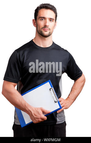 Personal Trainer, with a pad in his hand, isolated in white - Stock Photo