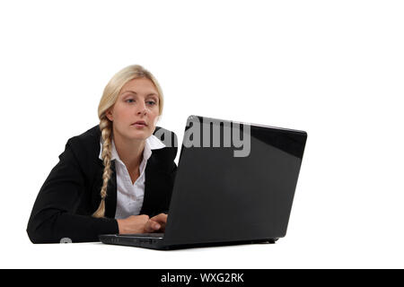 Uninterested blond office worker - Stock Photo