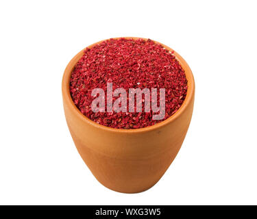 Ground red pepper in a bowl isolated on a white background. View from above. - Stock Photo