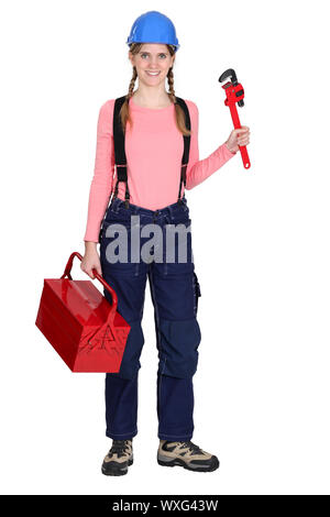 Tradeswoman with a pipe wrench - Stock Photo