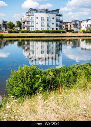 Bridge Wharf viewed from Dumsey Meadow, Across the River Thames, Chertsey, Surrey, England, UK, GB. - Stock Photo