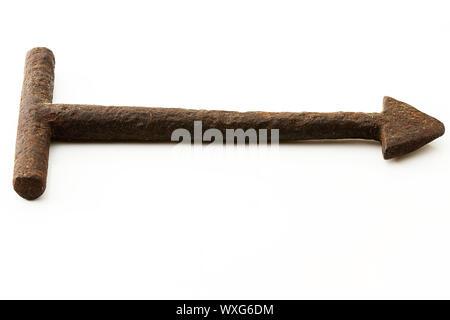 old rusty triangle key on white background - Stock Photo