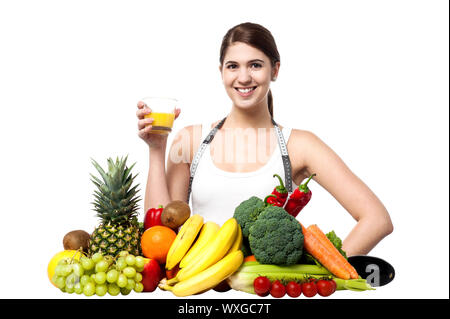 Beautiful young woman with fruits and glass of juice - Stock Photo