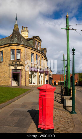UK, County Durham, Beamish, Museum, Town, historic Victorian Penfold hexagonal letter box outside Herron's Bakery - Stock Photo