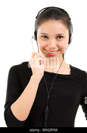 Telemarketing headset woman in black suit from call center smiling happy talking in hands free headset device. Beautiful mixed race Southeast Asian / - Stock Photo